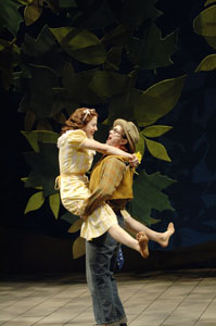 Country wench Audrey (Teri Watts, left) and the clown Touchstone (David Kelly) enjoy each other in the Forest of Arden. Photo: Jenny Graham.