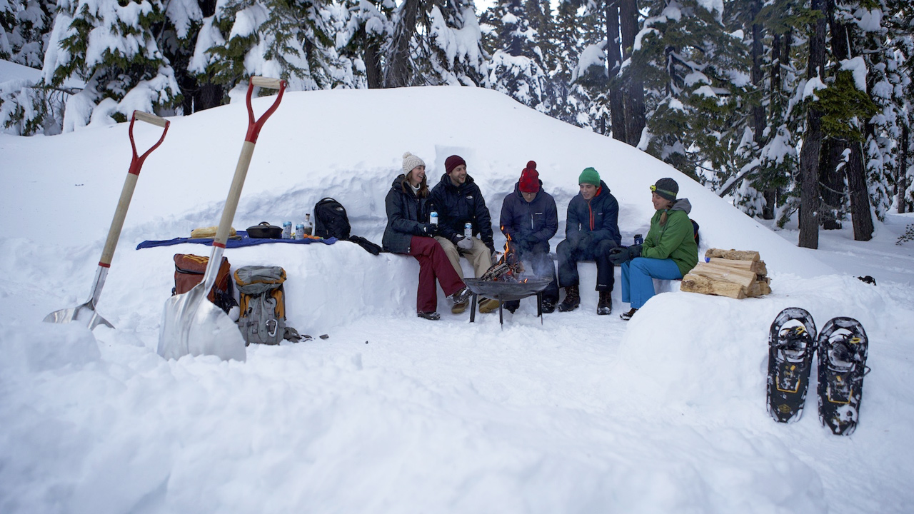 People sitting around together in the snow