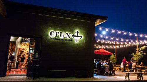 "The patio at Crux Fermentation Project is a great spot to enjoy  ""Sundowner Hour,"" which is the brewery's take on happy hour. (Photo credit: Matthew Lasala)"