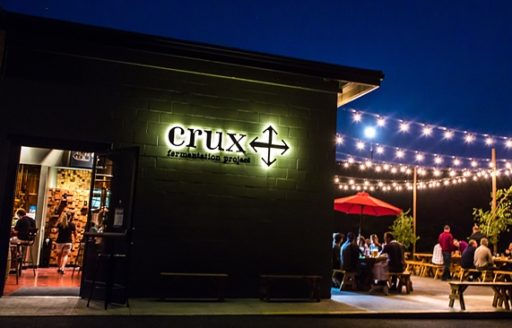 "The patio at Crux Fermentation Project is a great spot to enjoy <br> ""Sundowner Hour,"" which is the brewery's take on happy hour. (Photo credit: Matthew Lasala)"
