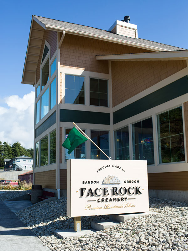 The exterior of Face Rock Creamery shows a bright modern building.
