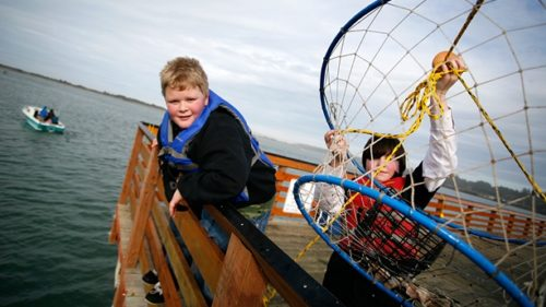 Crabbing for Dungeness from the dock is a great excuse to spend the day by the water with your family. (Photo credit: Don Frank)