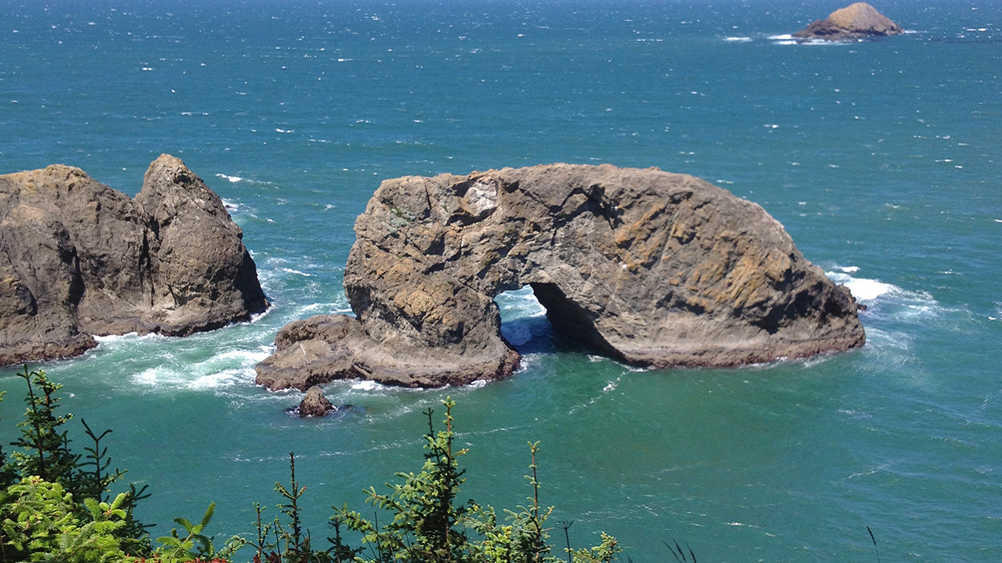 The aptly named Arch Rock sits in the Pacific Ocean.