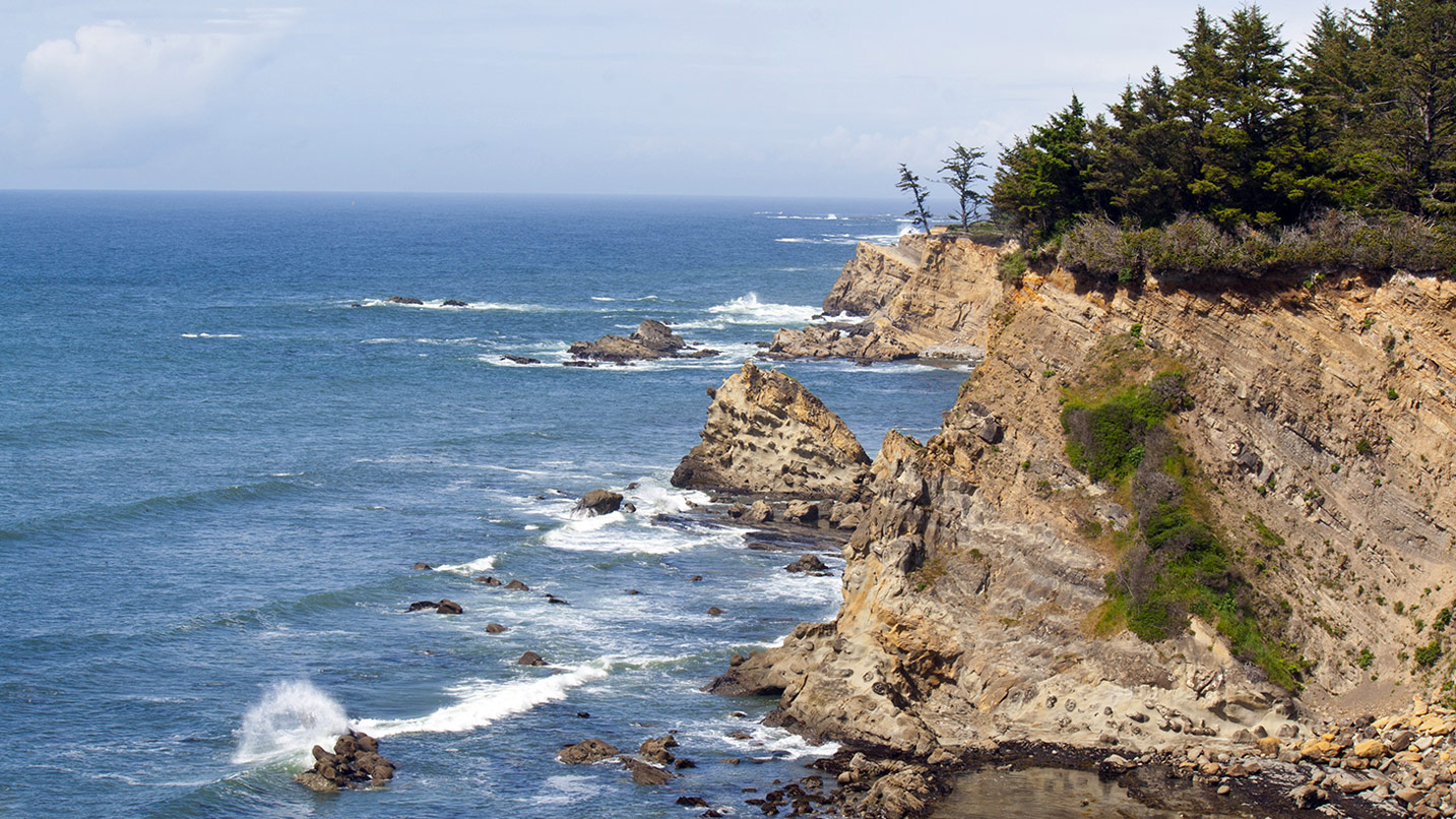 Waves lap against the rocky headland of Cape Arago.