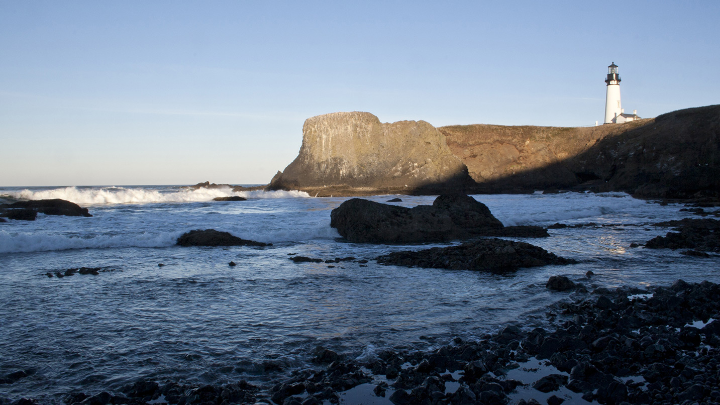 A view of Yaquina Head lighthouse from the tide pool area.