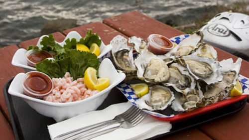 Try an oyster shooter or a steaming bowl of chowder at Pacific Oyster Company. (Photo credit: Robbie McClaran)
