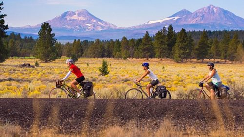 The 37-mile Sisters to Smith Rock Scenic Bikeway offers views of the lovely Deschutes River and the Cascade peaks on its way to Smith Rock State Park. (Photo credit; Russ Roca)