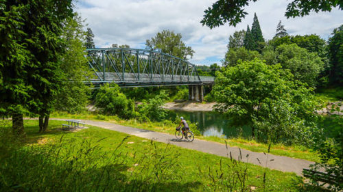 On the Oregon City-Gladstone trail, you'll cross the scenic Clackamas River and hop on the Trolley Trail, now a multi-use path.  (Photo credit: Russ Roca / PathLessPedaled.com)
