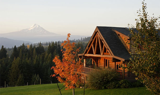 Autumn shows fall foliage and an orange glow on Sakura Ridge, with Mt. Hood in the background.