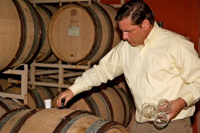 Chris pouring wine at Troon Vineyard