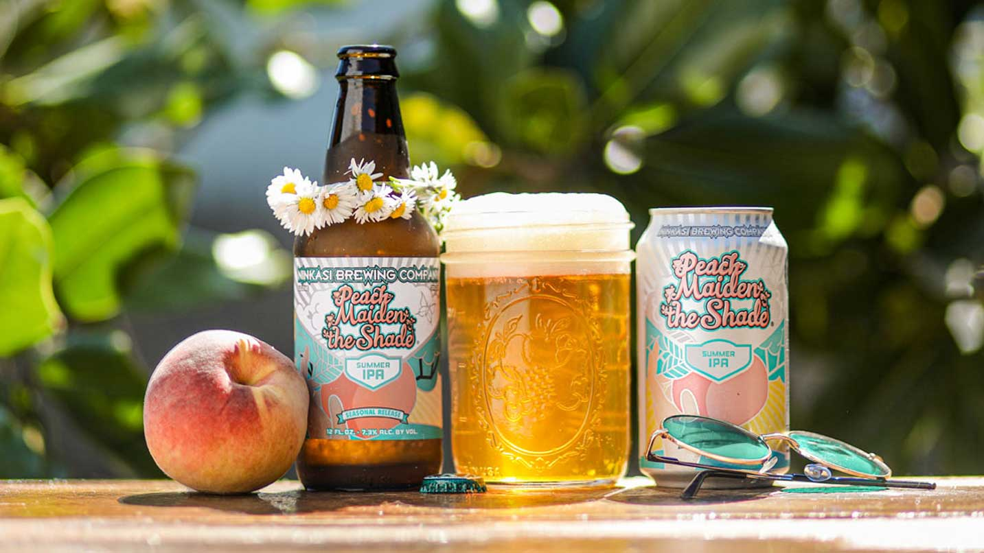 A peach, a bottle with a flower crown, a mason jar of beer, and a can.