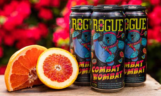 A sliced blood orange is set next to cans of Rogue Ales' Combat Wombat.