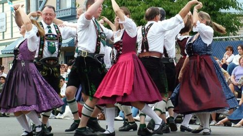 Wearing traditional Bavarian attire, dancers are seen in mid-swing at the Oktoberfest celebrations in Mt. Angel.