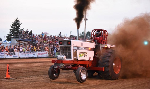 A tractor blows out smoke at the Sublimity Harvest Festival.