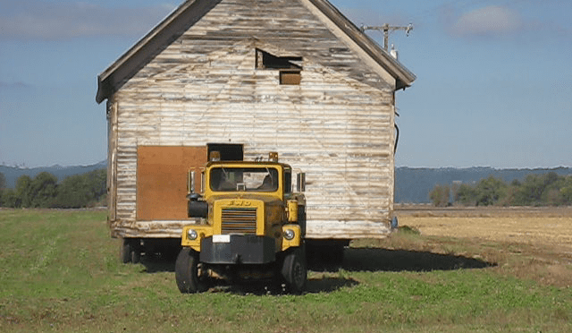 """""""The easiest and most expedient way was to take it across our farm fields and so we did,"""" added Tom. """"We only had to cross one county road and go under one power line and also ford a creek along the way – but we made it safe and sound."""""""
