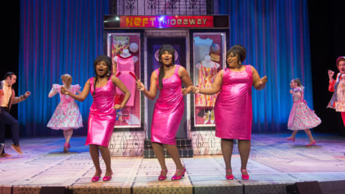 Hairspray—The Broadway Musical (2019): Kimberly Monk (Dynamite), Safiya Fredericks (Dynamite), Johnique Mitchell (Dynamite), Ensemble. Photo by Jenny Graham, Oregon Shakespeare Festival.
