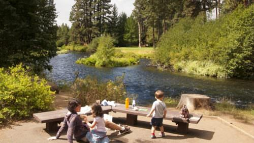 Lay a blanket along the Metolius River, a tributary of the Deschutes River in Central Oregon. (Photo credit: Robbie McClaran)