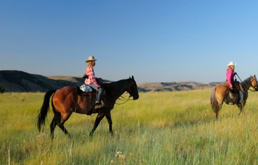 Saddle up for an authentic ranch experience at Wilson Ranches Retreat in Fossil. (Photo credit: Christian Heeb)