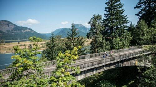 There are miles-long cycling paths along the Historic Columbia River Highway that are car-free. (Photo credit: Russ Roca)
