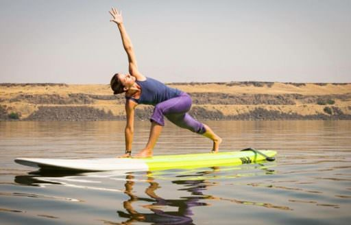 Paddleboarding improves your body's core strength, which is a key component of yoga. (Photo credit: Float On SUP Yoga)