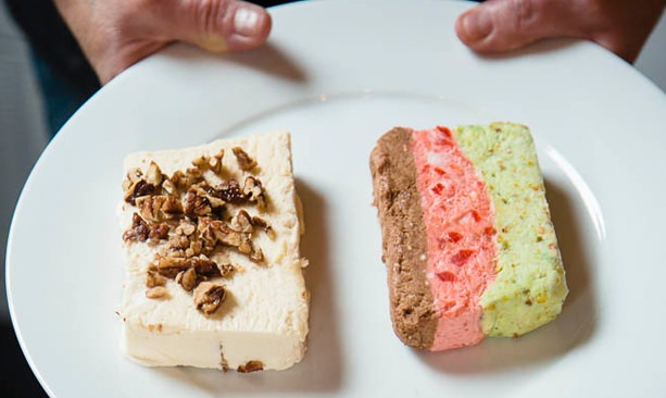 Two slices of colorful ice cream cake