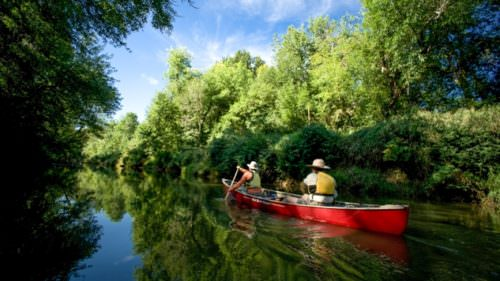 In summer months, the current on the 40-mile Tualatin River Water Trail is usually mellow enough for an easy upstream paddle and a relaxing float. (Photo credit: Mark Gamba)