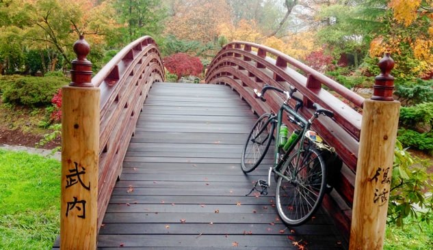 Bike leans against a bridge in the Tsuru Island Japanese garden