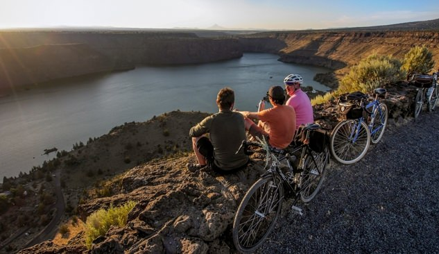 Bicyclists take a break to admire Lake Billy Chinook