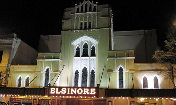 Salem's Elsinore Theater has a haunting look at night, with dramatic lights and shadows.