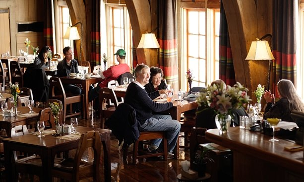Guests enjoy the Cascade Dining Room at Timberline Lodge