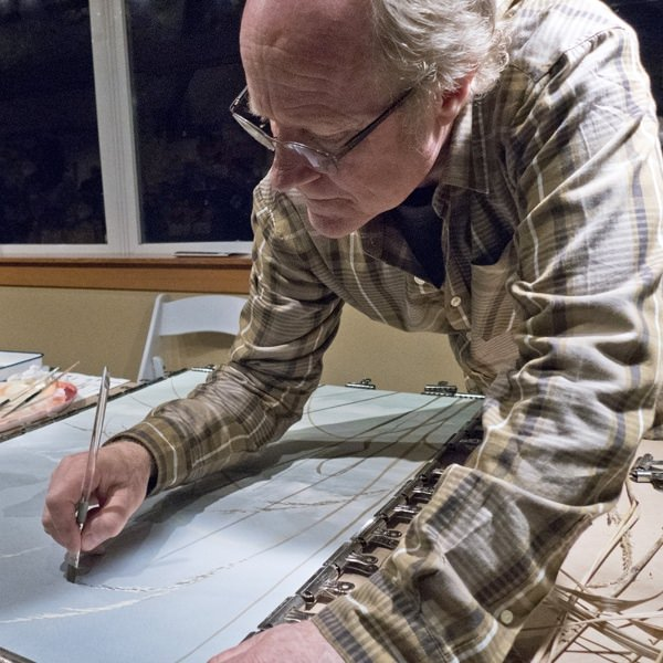 Cannon Beach resident artist Jeffrey Hull working on a watercolor at the Arts in Action event.