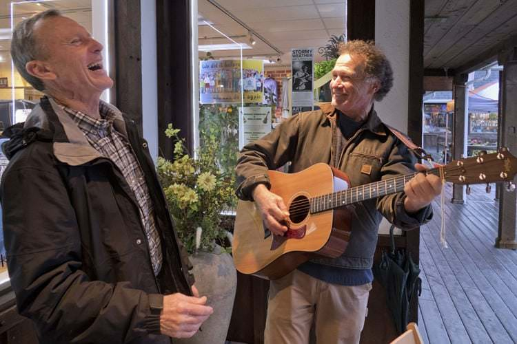 "Jay Speakman and Jon Broderick perform songs celebrating the fishing industry during Saturday's ""Music Around Town"""