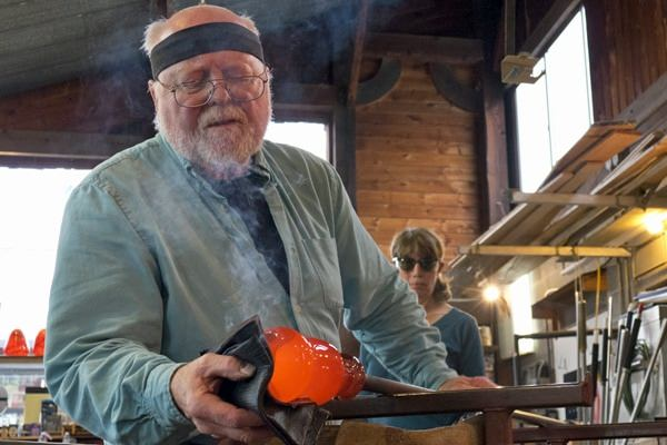 Glassblowing artist Jim Kingwell works shapes a piece during Stormy Weather Arts Festival.