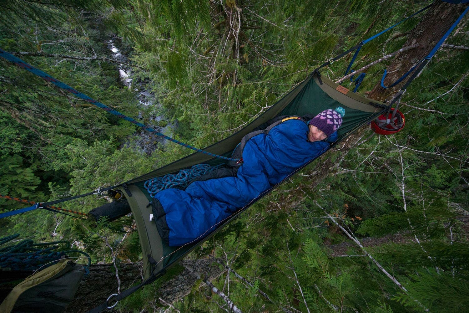 Curled up in a sleeping bag in a Treeboat far above the ground