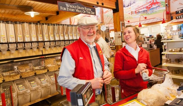 Bob Moore of Bob's Red Mill laughing with an employee.