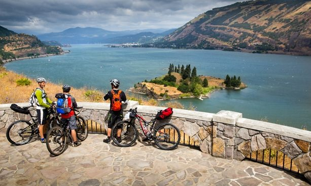 Cyclists take a break to look at Memaloose Island