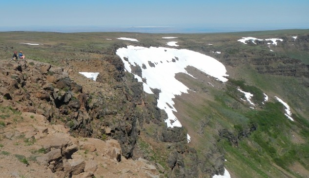 Patches of snow remain on the massive Kiger Gorge