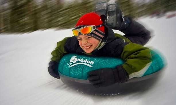 Kid smiling on Hoodoo tube