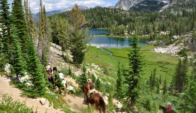 Visitors horse-pack around the lush Wallowas