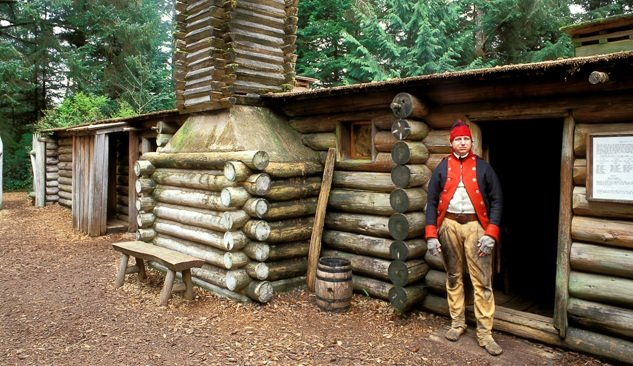 A sentry in front of the captain's quarters at Fort Clatsop (Lewis & Clark's 1805-1806 winter post)