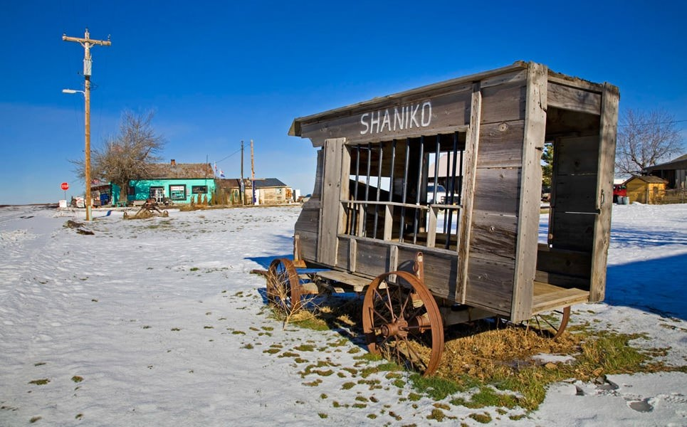 A broken-down stagecoach sits in the ghost town of Shaniko.