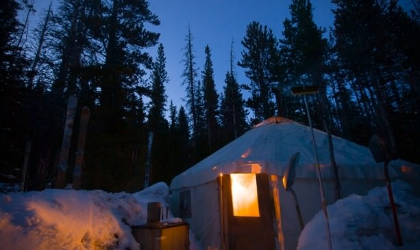 A yurt glows in the darkness.