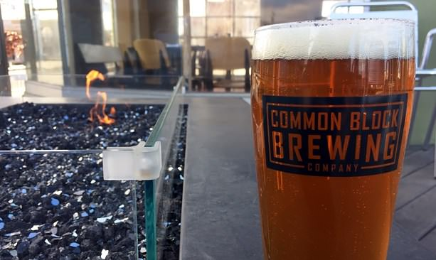 Common Block pale ale next to outdoor fire pit