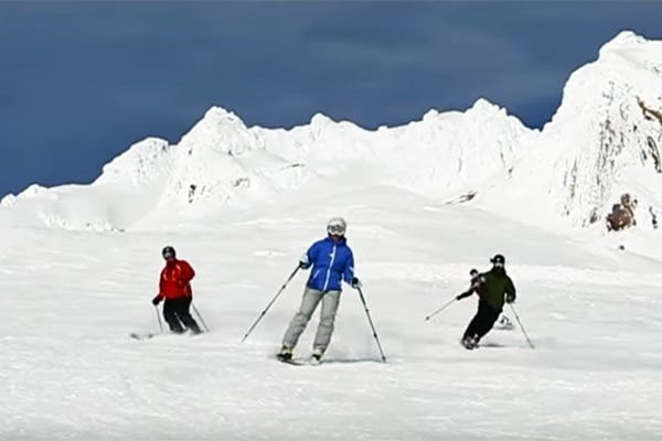 Three skiers on Mt. Hood