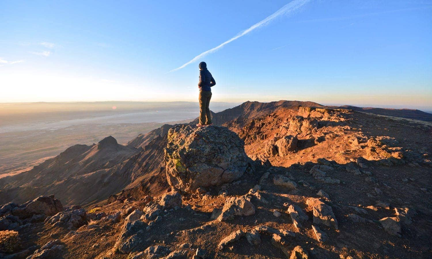 Man looking from sunrise at Steens Mountain