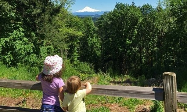 Kids look at Mt. Hood from Scouters Mountain Nature Park