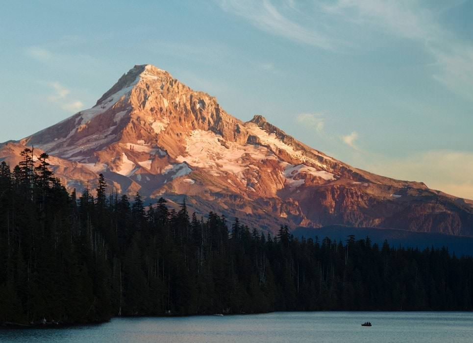 Mt. Hood looms large over a lake at sunset