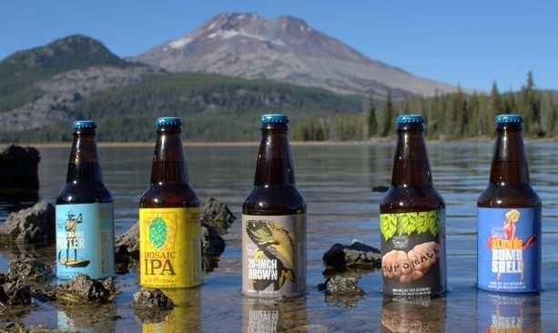 Bottles of Bend's popular beers sitting in a Central Oregon lake