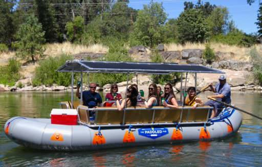 The Paddled Pub takes you down the scenic Rogue River on a custom raft designed for relaxation. (Note: guests wear hip-belt PFDs. Photo credit: The Paddled Pub)