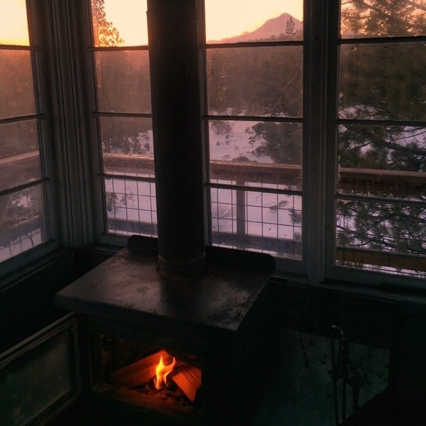 View of Mt. Hood at sunset from inside Fivemile Butte lookout
